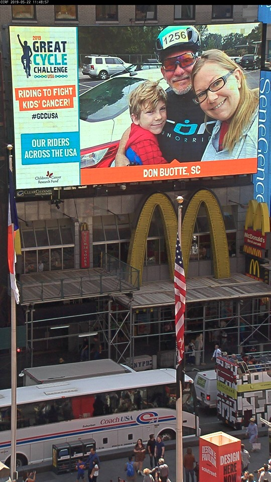 Picture of Don Buotte on large monitor in Times Square