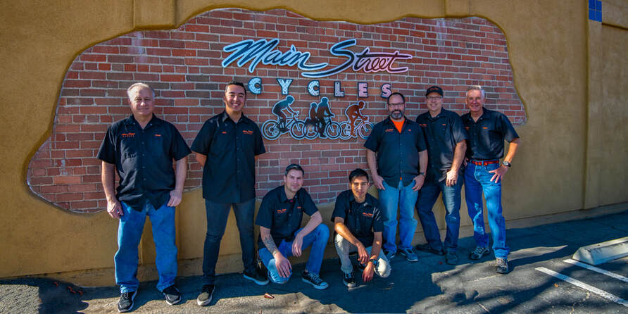 Main stree crew in front of their store